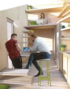 Interiören i en tänkt lägenhet. En smal trappa leder upp till ett sovloft. Längs me ena väggen är köket och mot den andra där det finns ett fönster står ett bord.